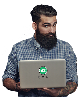Bearded man holding Simia pro laptop